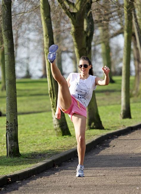 Imogen Thomas stretching in the Park
